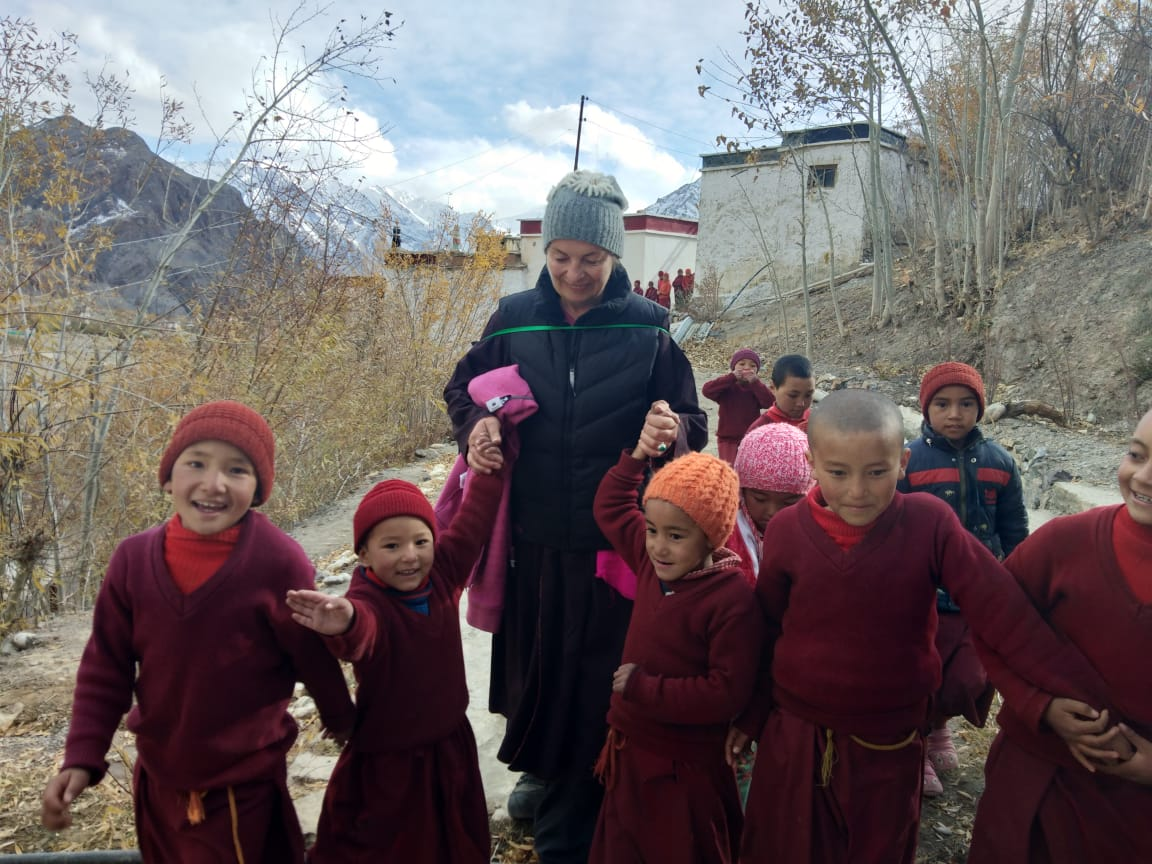 Project volunteer Irina Safonova with the young nuns of Zanskar, a remote nunnery in India.